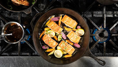Salmon in a cast iron pan on the stove at 4UR Ranch