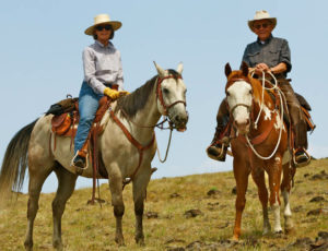 Couple on a trail ride at 7D Ranch