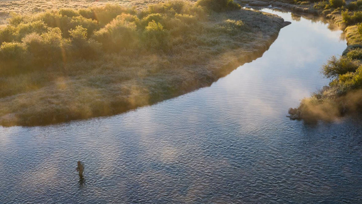 Drone shot of a guest fly fishing at A Bar A Ranch
