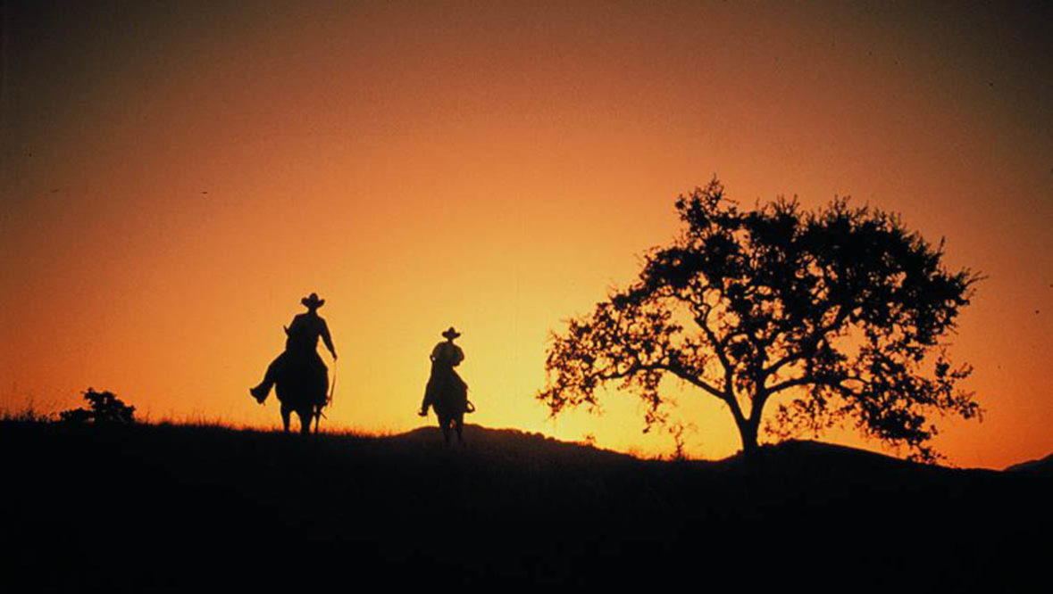 Two riders at sunset at Alisal Guest Ranch
