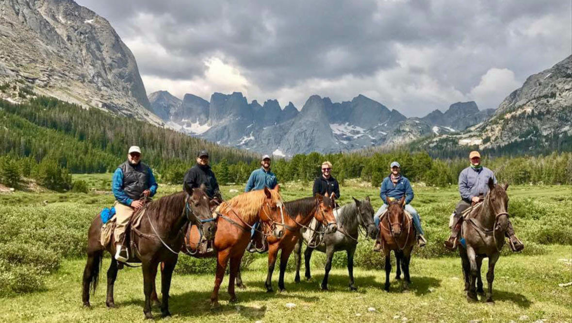 Guests on a trail ride at Allens Diamond 4 Ranch