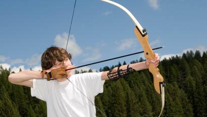 Boy doing archery at Bar W Ranch