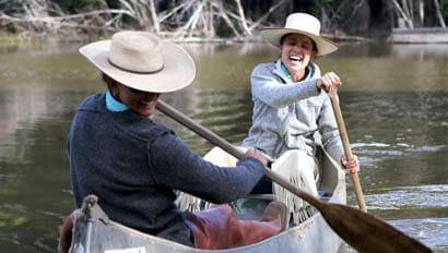 Two guests canoeing at Black Mountain Ranch