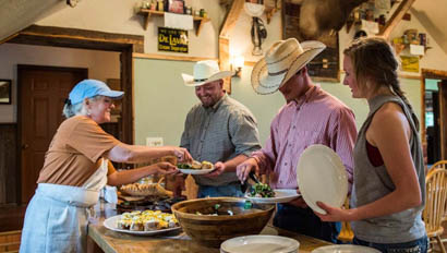 Staff serving guests dinner at Blacktail Ranch