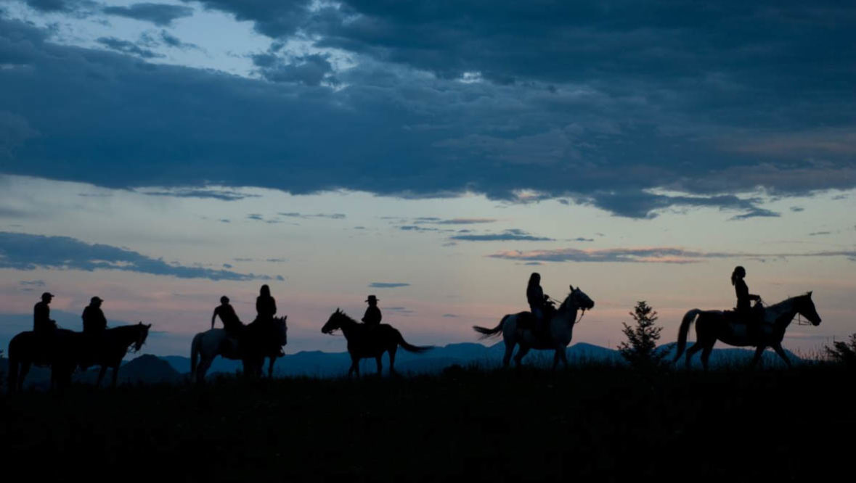 Trail ride at sunset at Blacktail Ranch