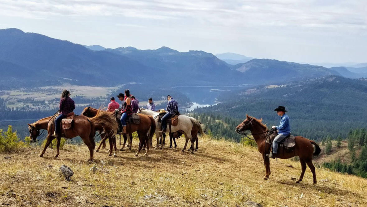 Horses and riders looking out at the view at Bull Hill Ranch