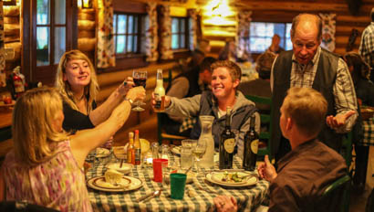 Family cheers at dinner at CM Ranch