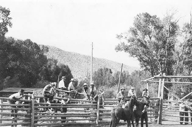 Historical photo of guests on horses