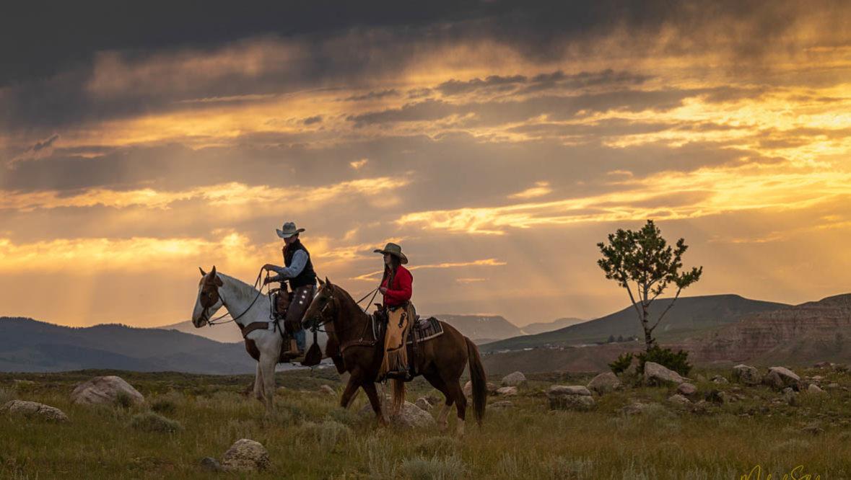 Two riders at dawn at CM Ranch