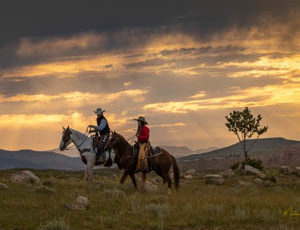 Two riders at dawn at CM Ranch