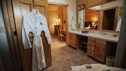 Cabin bathroom with robe at Lost Valley Ranch