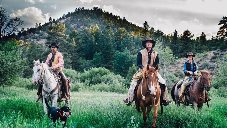 Three guests on horses at Cherokee Park Ranch
