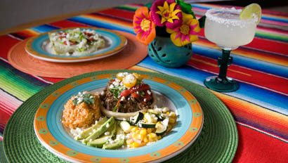 Plate of food and a margarita at Circle Z Ranch