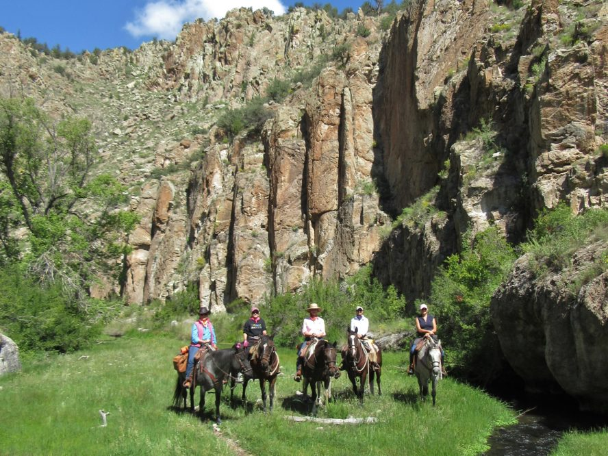 group of women on horses in canyon
