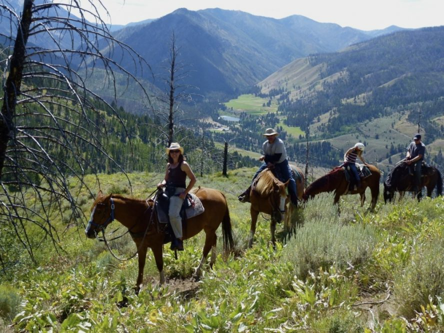 trail ride with horses and mountains
