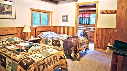 Bedroom cabin at Drowsy Water Ranch