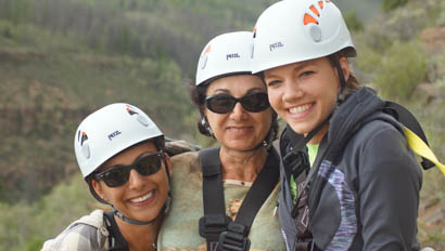 Three women with zip-lining helmets at Drowsy Water Ranch