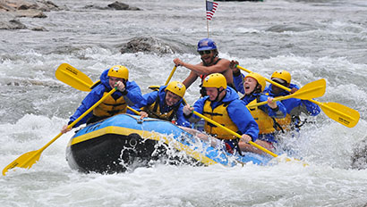 Elk Mountain Ranch group of people white water rafting