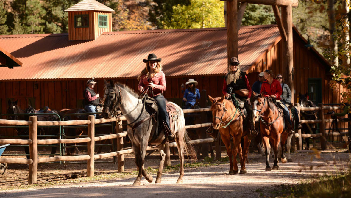 Guests on horses at The Broadmoor's Ranch