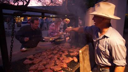 Staff member grilling meat at Elkhorn Ranch Arizona