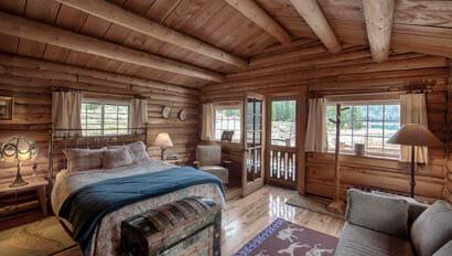 Cabin bedroom at Flat Creek Ranch