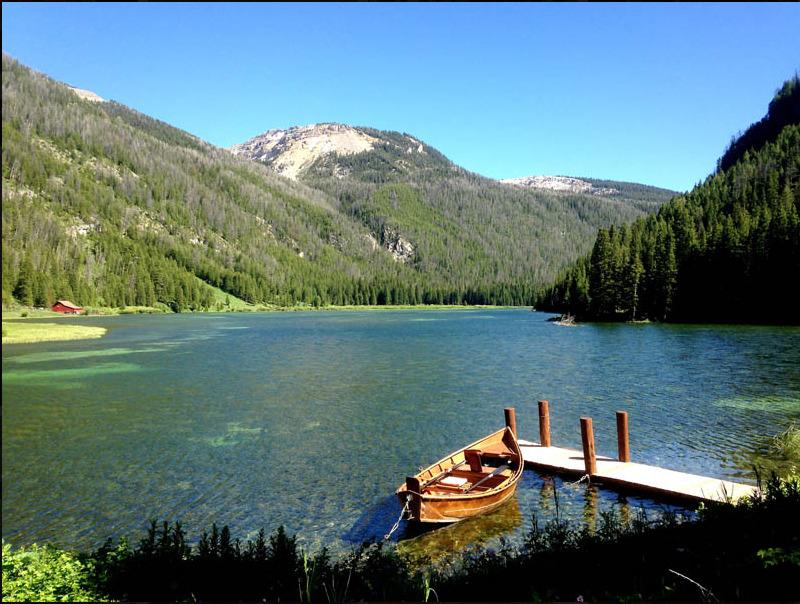 Boat in lake at Flat Creek Ranch