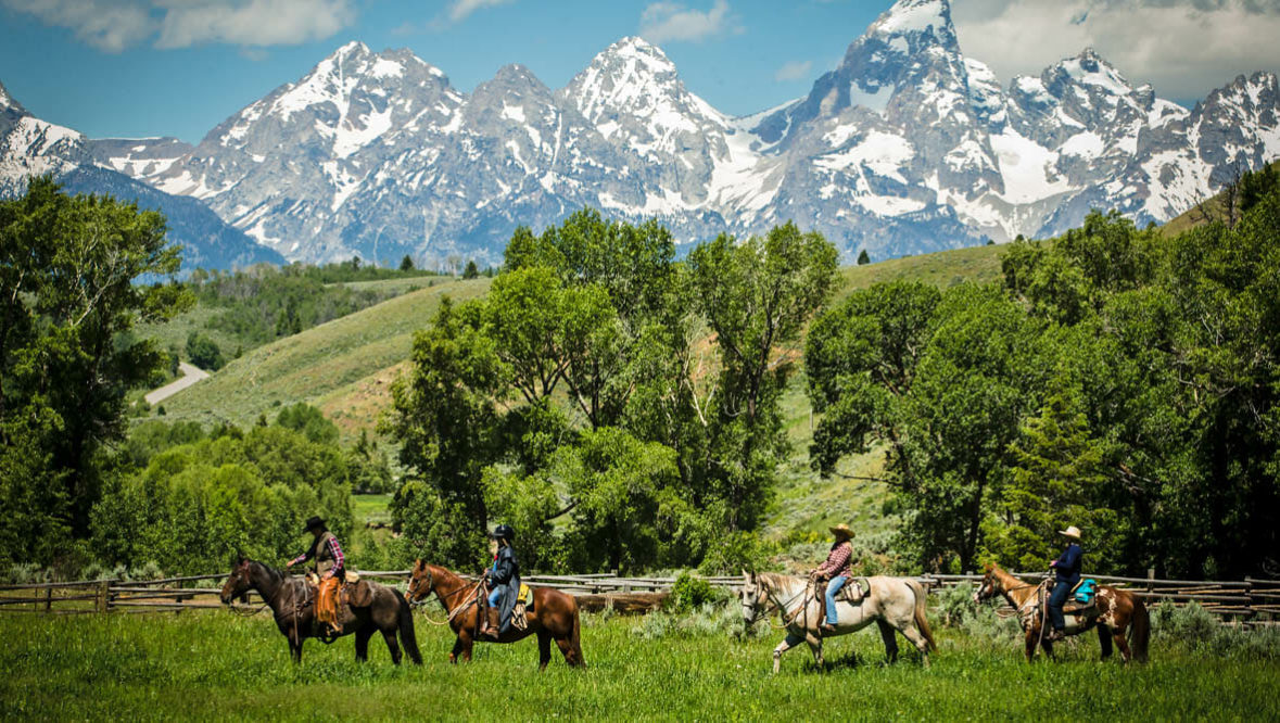 Trail ride with Grand Tetons view at Gros Ventre River Ranch