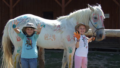Kids painting a horse at Goosewing Ranch