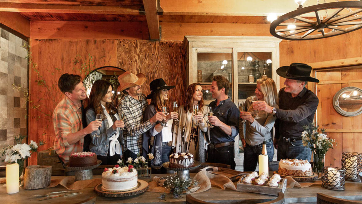 Family cheers in lodge kitchen at Greenhorn Ranch