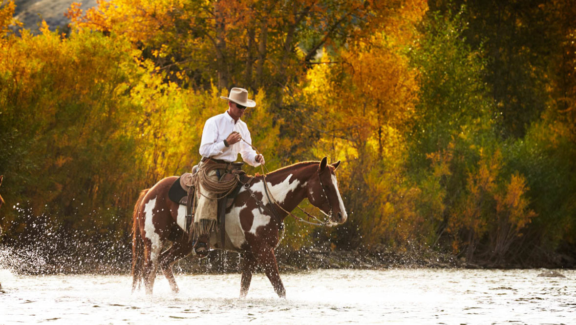 Cowboy on a paint horse at Gros Ventre River Ranch