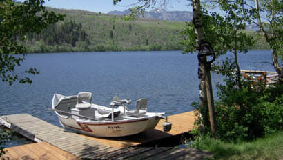 Boat on dock at fishing lake at Hubbards Ranch