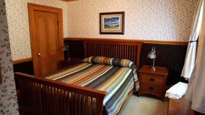 bed and side table in cabin