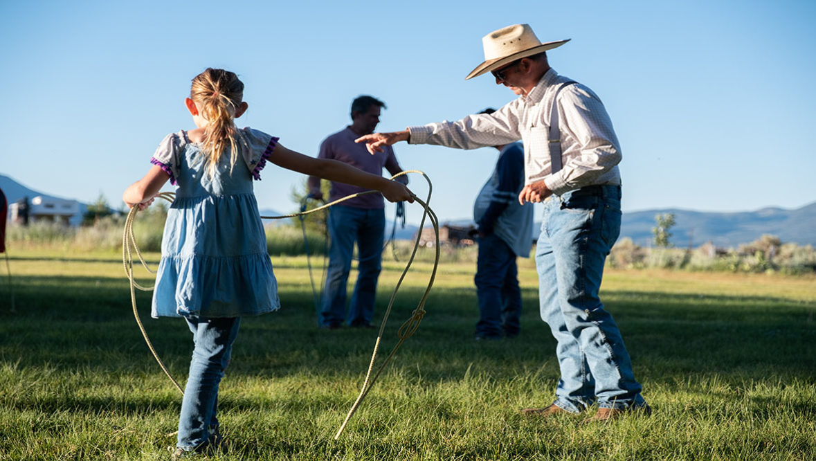 Hunewill Ranch cowboy teaching kid how to rope
