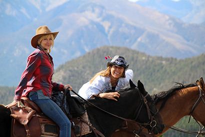 JJJ Wilderness Ranch two cowgirls on horses