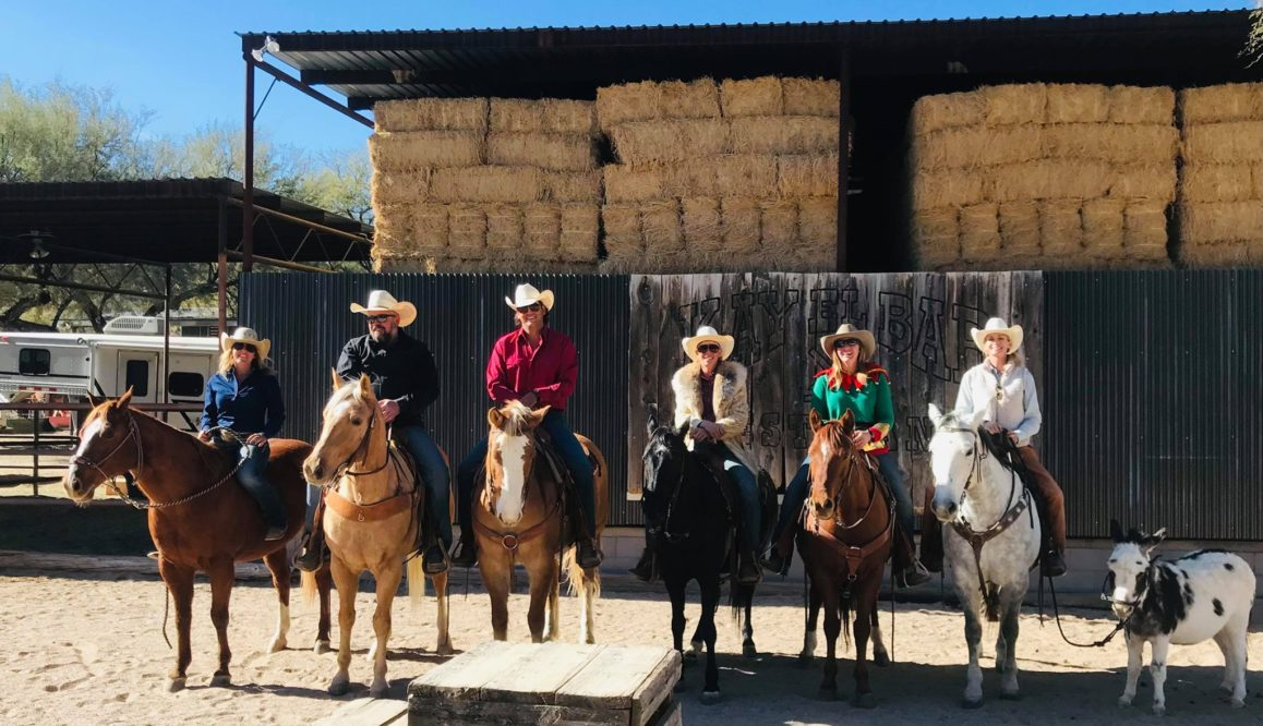 group of riders with cowboy hats lined up