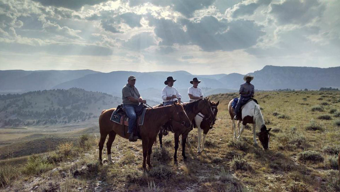 Guests looking at the view on a trail ride at Klondike Ranch