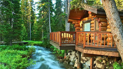 Lodge by a creek at Lone Mountain Ranch