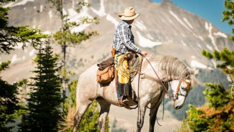 Cowboy near a mountain at Lone Mountain Ranch