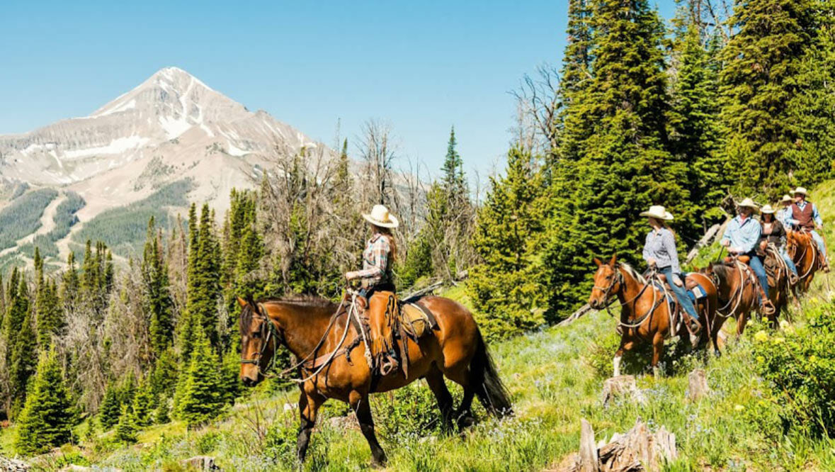 Family trail ride at Lone Mountain Ranch