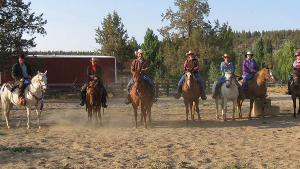Group riding horses at Long Hollow Ranch