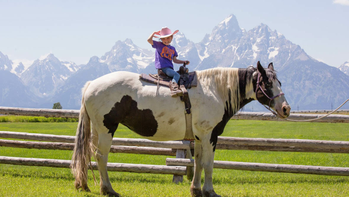 Little cowgirl on a horse at Lost Creek Ranch