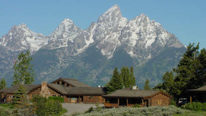 Lodge with Mountains in the background at Lost Creek Ranch