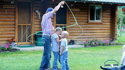 Kids being roped by a Cowboy at McGarry Ranch