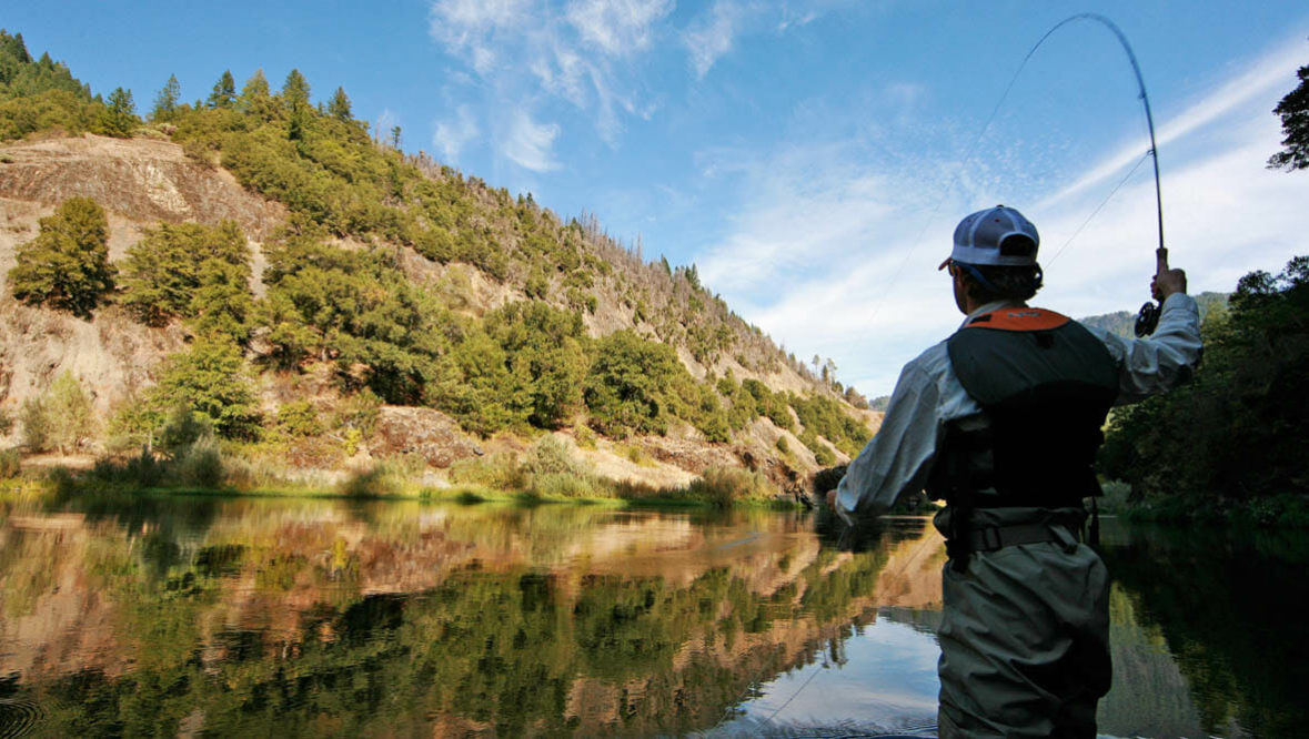 Man fly fishing at Marble Mountain Ranch