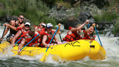 Group of guests white water rafting at Marble Mountain Ranch