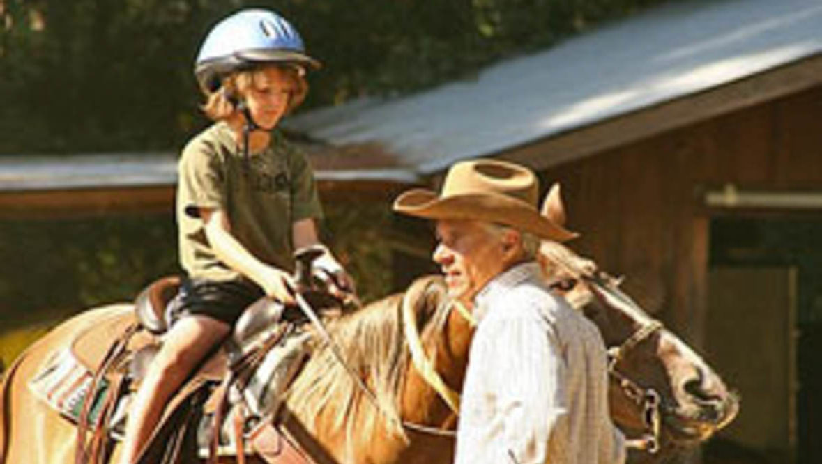 Grandparents with child on a horse at Marble Mountain Ranch