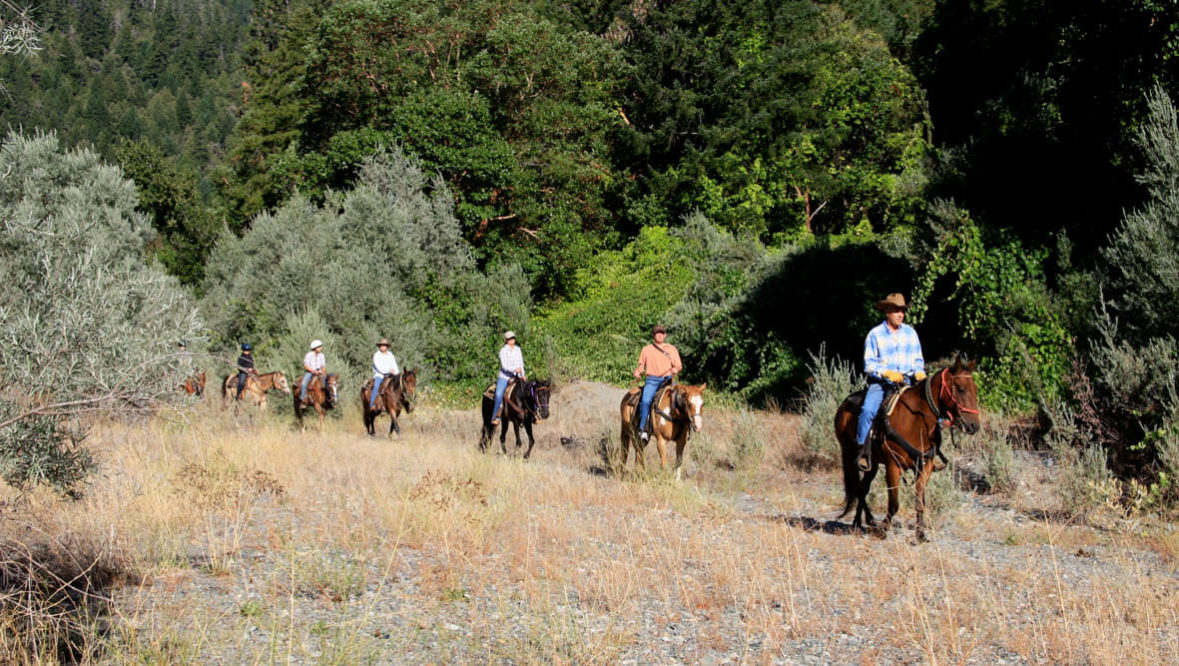 Family trail ride at Marble Mountain Ranch