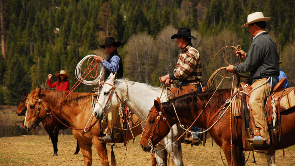 Three cowboys with lassos at McGinnis Meadows Cattle Ranch