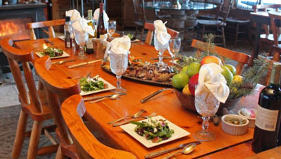 Set dining table with food at Medicine Bow Lodge
