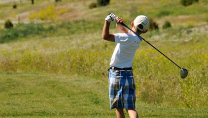 Kid playing golf at Mountain Sky Guest Ranch